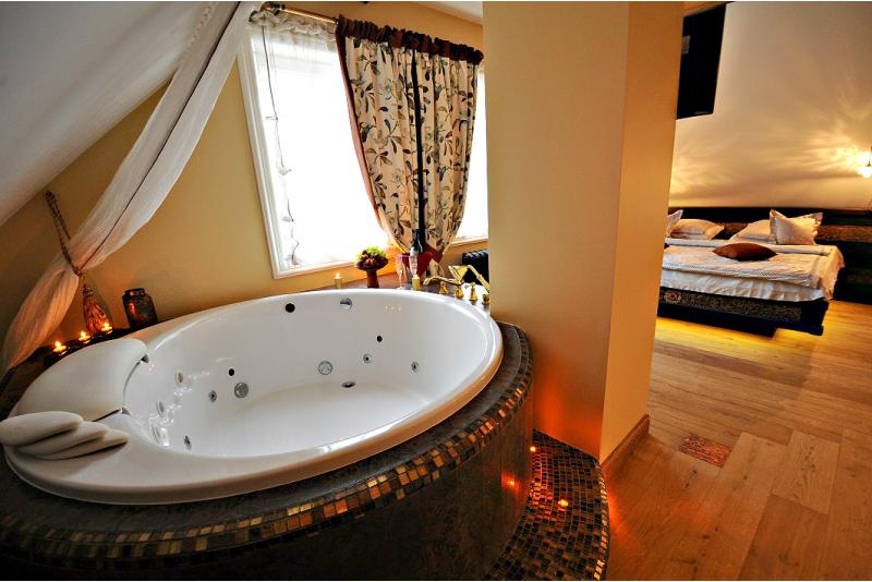 """Poilsis apartamentuose su sūkurine vonia apartamentuose """"Argo"""""""