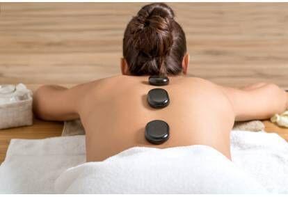 Gydomasis masažas su karštais akmenimis Didlaukio klinikoje